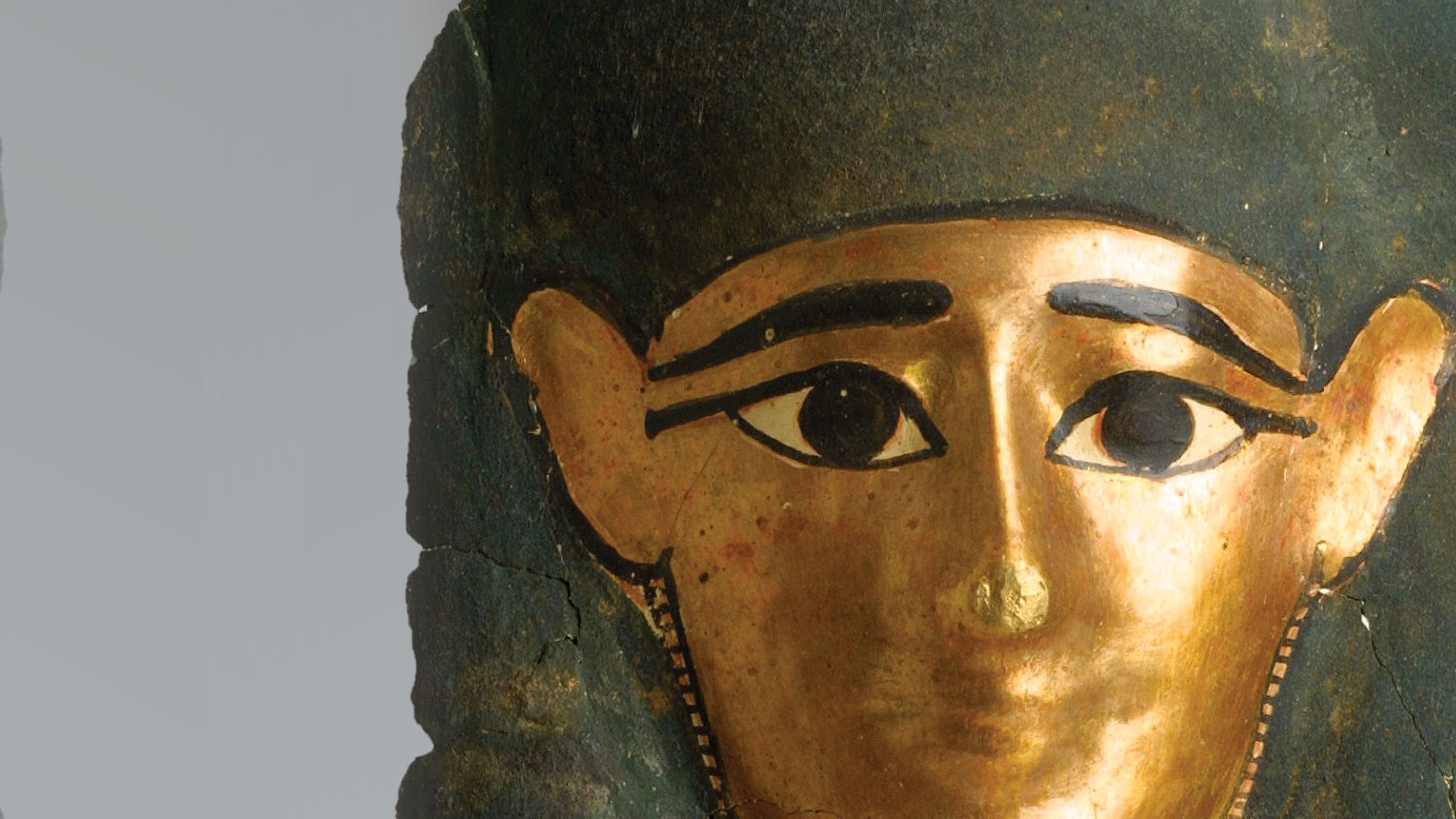 A close up of an Egyptian mummy mask from the                Senusret Collection