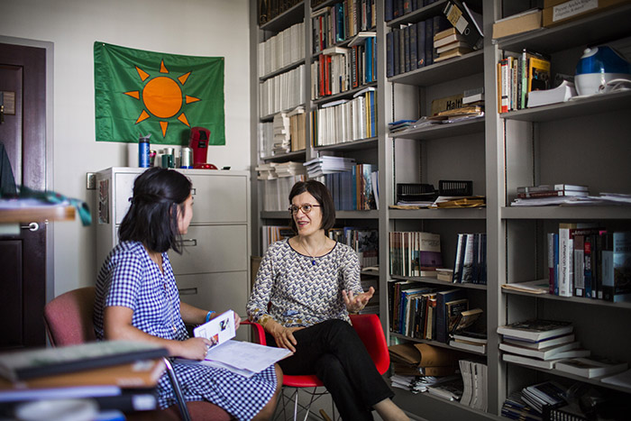 A professor and student talk in a professor's office
