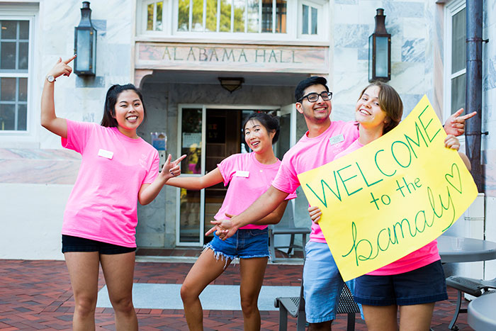 Student volunteers greet new Emory students moving into Alabama Hall.