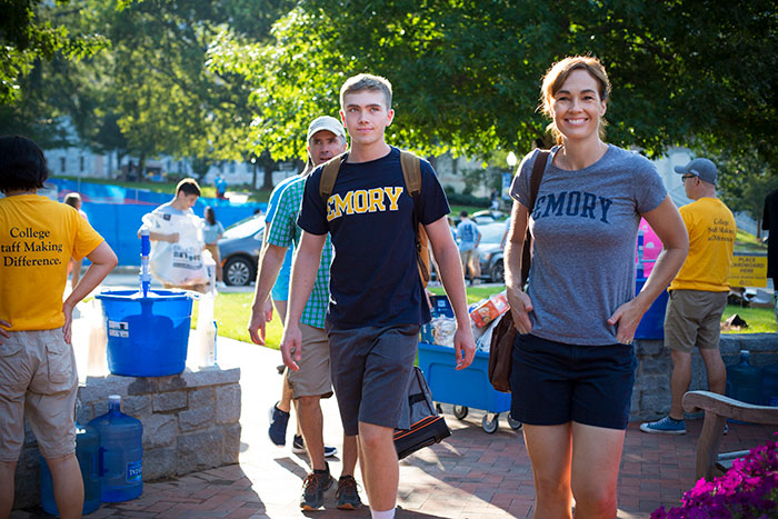 A new student is joined with his family on Move-In Day.
