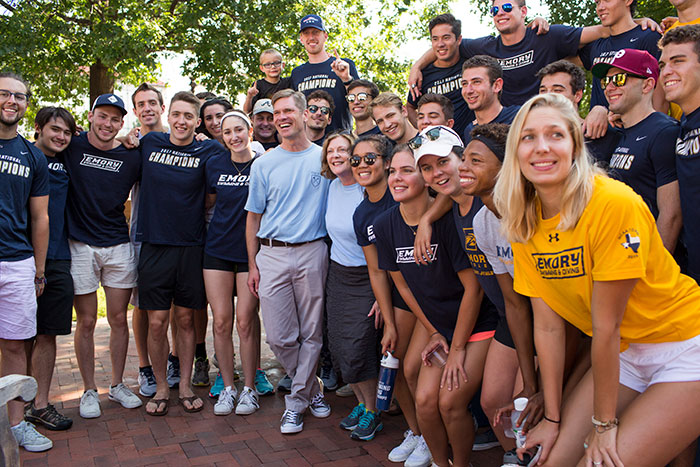 The Emory Swimming and Diving team poses with President Claire E. Sterk.