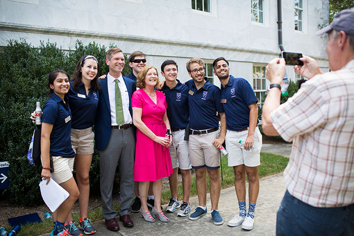 Emory President Claire E. Sterk poses with the Emory College dean and student leaders at the 2017 Coke Toast.
