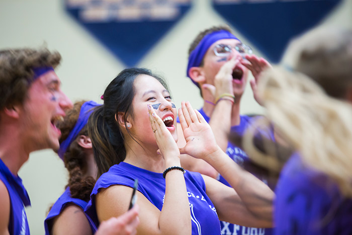 Oxford College students wear spirited face paint and cheer on their teammates at the Oxford Olympics.