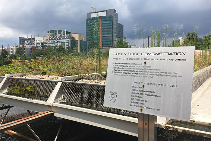 On the green roof on Facilities and Maintenance Building B, a sign explains that the three green roof systems evaluate and compare storm water retention, storm water quality, growth media, plant palette performance characteristics and comparative temperature readings.