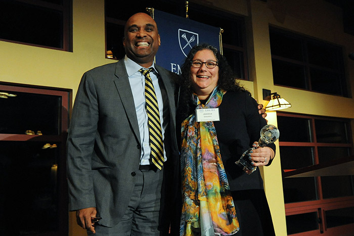 Emory Provost Dwight McBride congratulates Jessica Dworkin, assistant dean of graduate programs at the School of Law, who received the International Outreach Award.