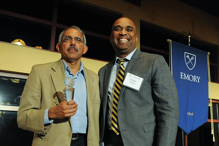 Emory Provost Dwight McBride congratulates K.M. Venkat Narayan, director of the Emory Global Diabetes Research Center, who received the Marion V. Creekmore Award for Internationalization.