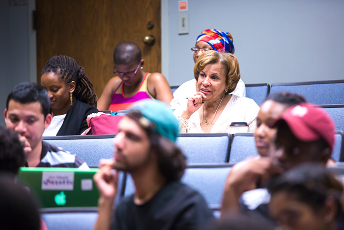Cynthia Neal Spence, director of UNCF/Mellon programs, sits in the audience as students participate in the roundtable discussion.