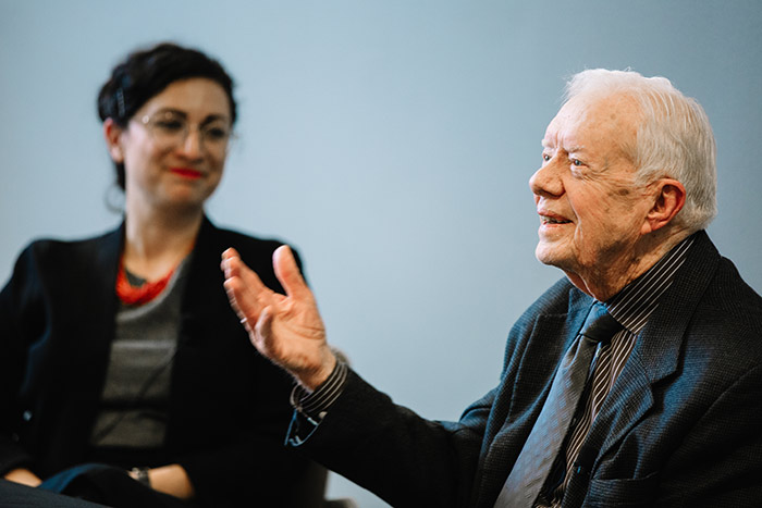 President Carter, seated next to history professor Tehila Sasson, responds to students.