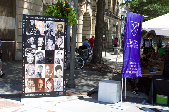 The Emory tent includes a banner of famous Emory authors.