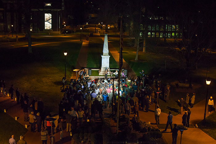 Professors Bobbi Patterson and Eloise Carter lit a flame at Few Monument representing the lamp of learning.