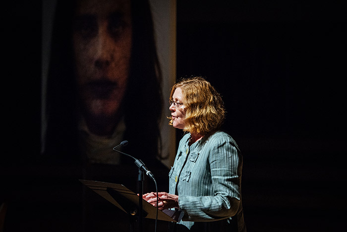 Emory President Claire E. Sterk spoke at the unveiling.