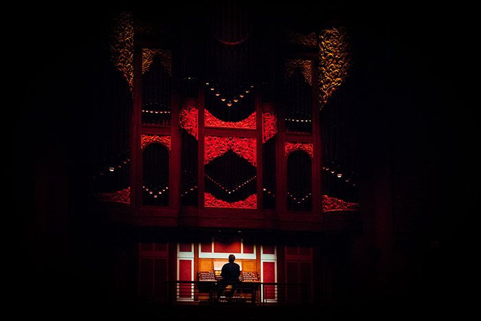 Emory's Timothy Albrecht played the organ in low-lighting throughout the event to help set the mood.
