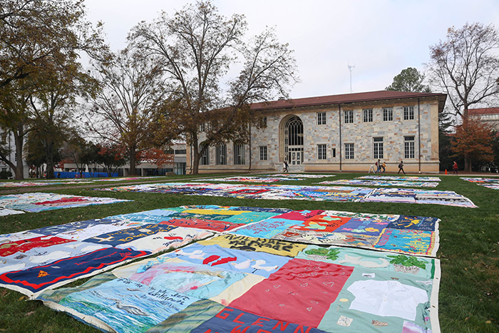 Dozens of quilts lay spread out across the Emory quad to commemorate World AIDS Day.