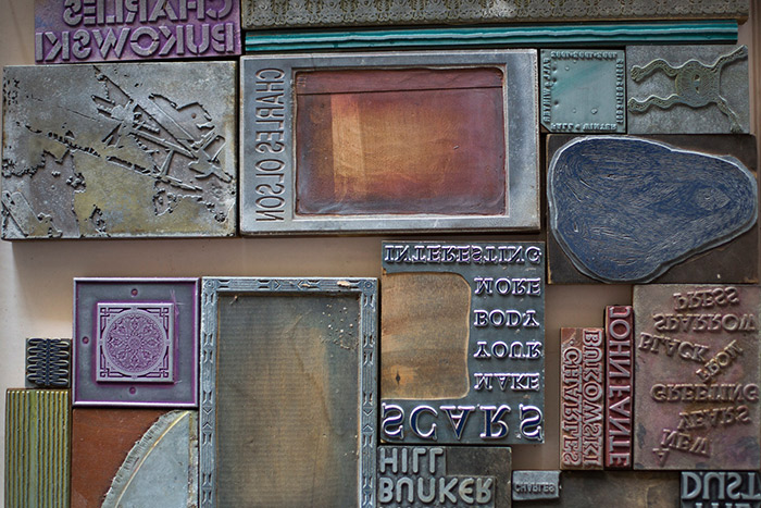 Several original printing blocks of various colors and conditions.