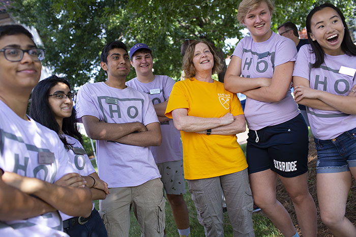 Emory President Claire E. Sterk poses with a group of student volunteers