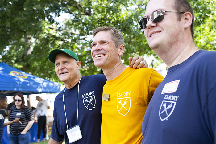 Emory College Dean Elliott poses with Emory staff members helping students move in