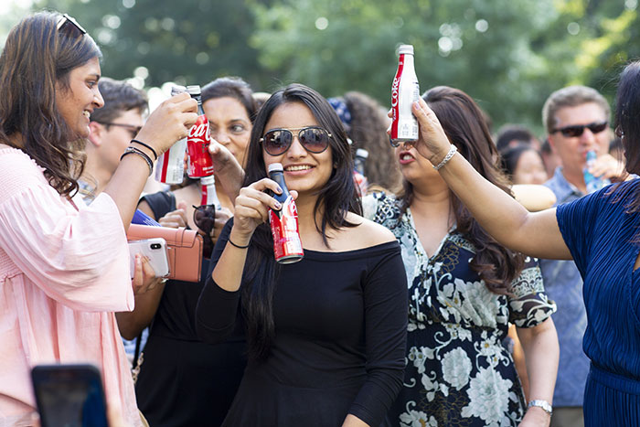Students hold up various cokes for the Coke Toast