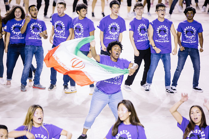 A student performs with a flag at Songfest