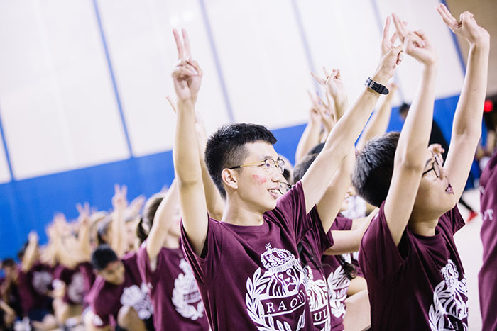 Students in maroon perform at Songfest