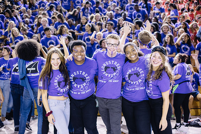 Students in purple pose at Songfest
