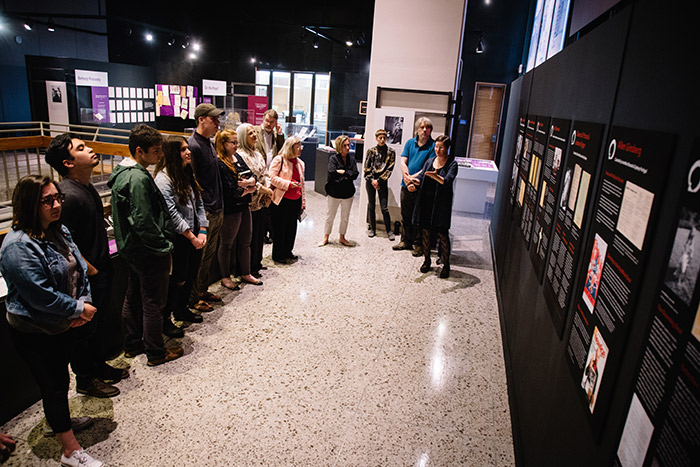 A dozen Emory community members check out items on display