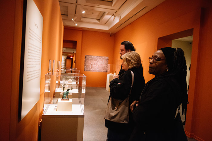 Members of the Emory community look at items in the gallery