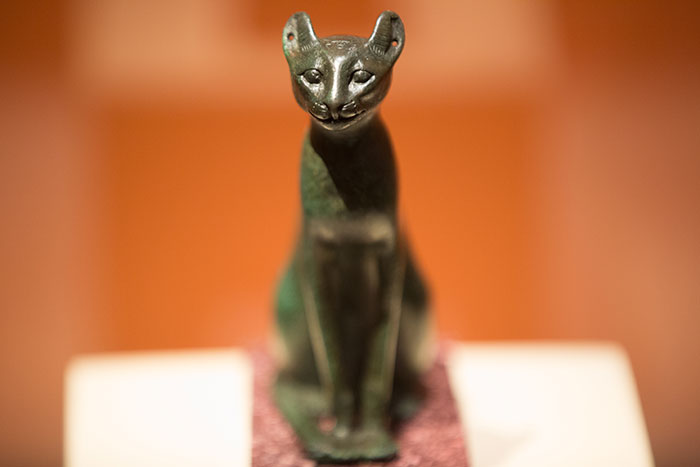 A small sculpture of a cat on display at the exhibit
