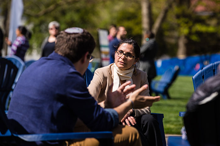 Two Emory community members sit and chat at the first Conversations on the Quad.
