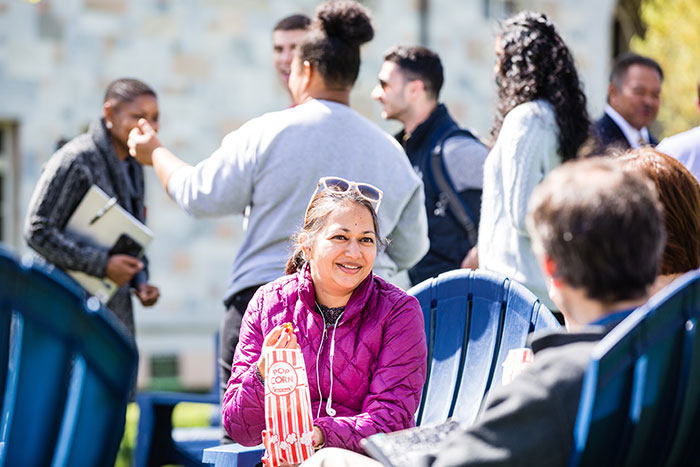 An Emory community member eats popcorn, one of the light snacks available, at Conversations on the Quad