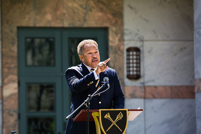 Robert M. Franklin Jr., Senior Adviser of the President, speaks at a podium at the first Conversations on the Quad