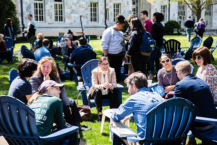 Eight Emory community members sit gathered in a circle at the first Conversations on the Quad