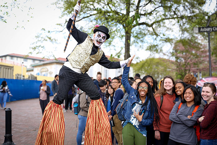 A performer stands on stilts at Dooley's Week