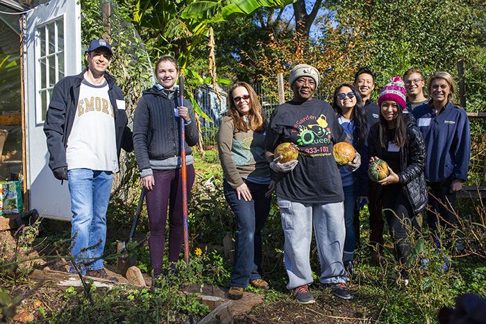 Students work in the field at the West End Community Garden