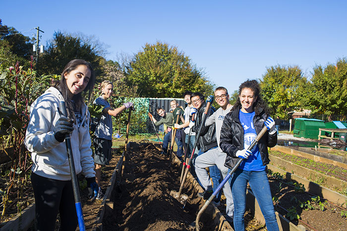 Students tend the garden at Truly Living Well Center