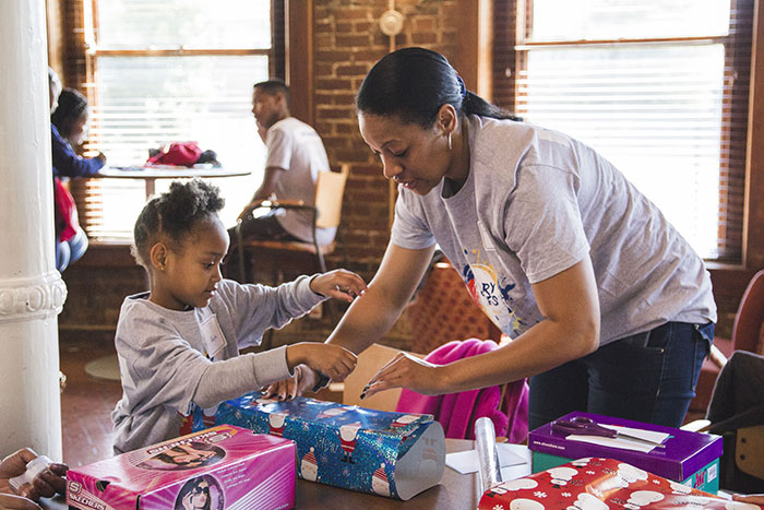 Students help wrap gifts