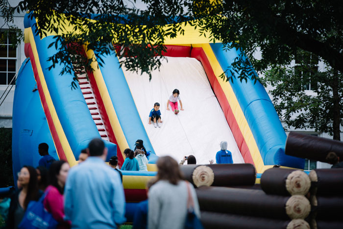 Children slide down an inflatable slide at the Homecoming Festival