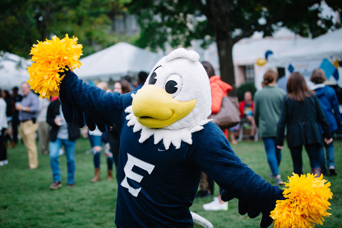 Emory mascot Swoop holds pom-poms at the Homecoming Festival