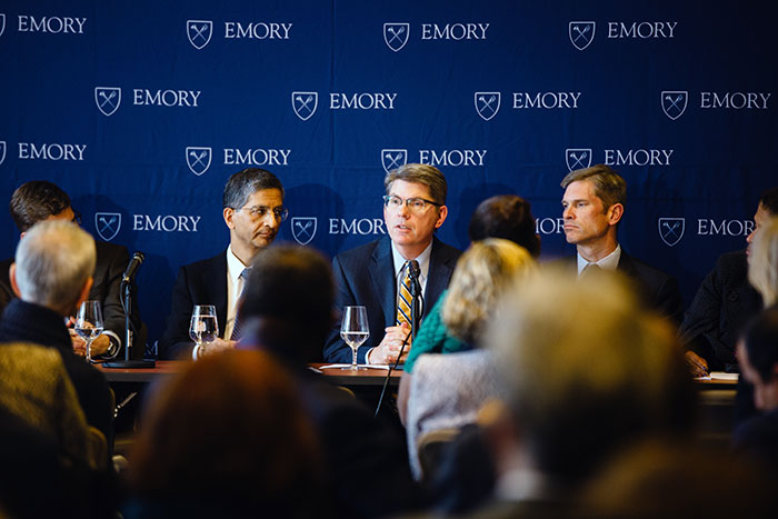 Douglas A. Hicks, dean of Oxford College (center), addresses the group as Vikas P. Sukhatme, dean of the Emory School of Medicine (left), and Michael Elliott, dean of Emory College, look on.