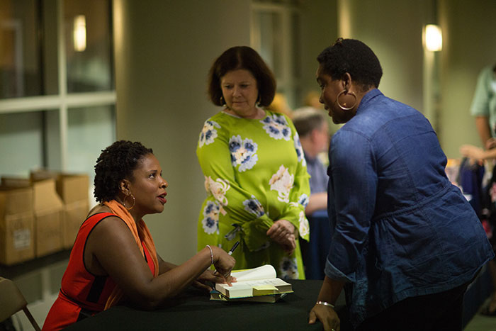 Tayari Jones speaks with an audience member individually after the discussion.