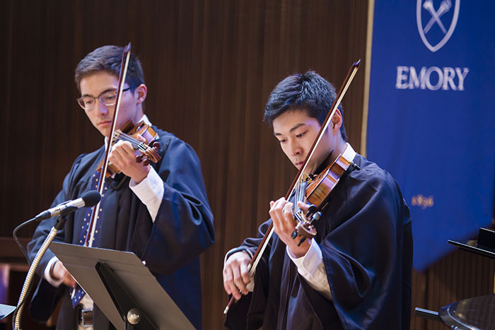 Student musicians play violins