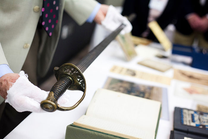 Randall Burkett holds a Confederate sword from the William H. Scott collection