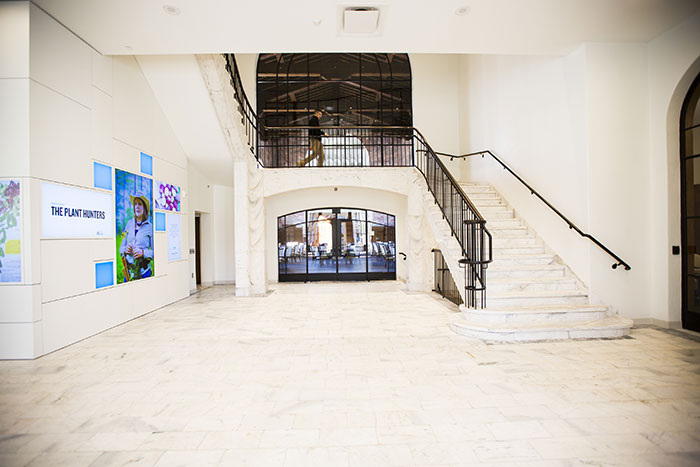 An interior view of the foyer highlighting the 100-year-old marble stairs and digital displays