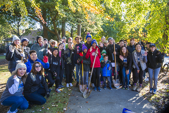 Students pose for a photo with shovels