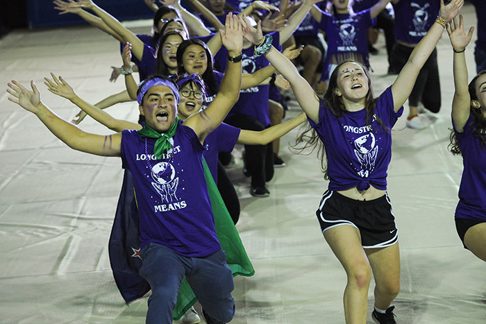 Students in purple t-shirts for the Longstreet Means residence hall dance and sing