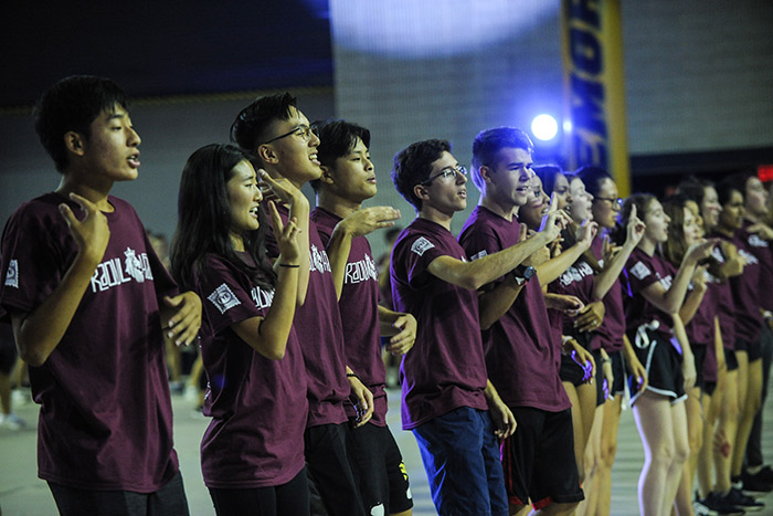 Students in maroon Raoul Hall t-shirts dance in sync