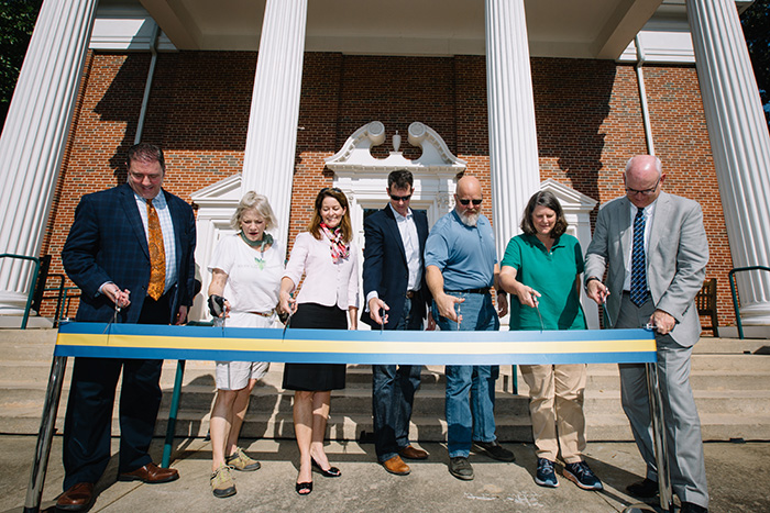 Several Emory community members cut a ribbon with scissors