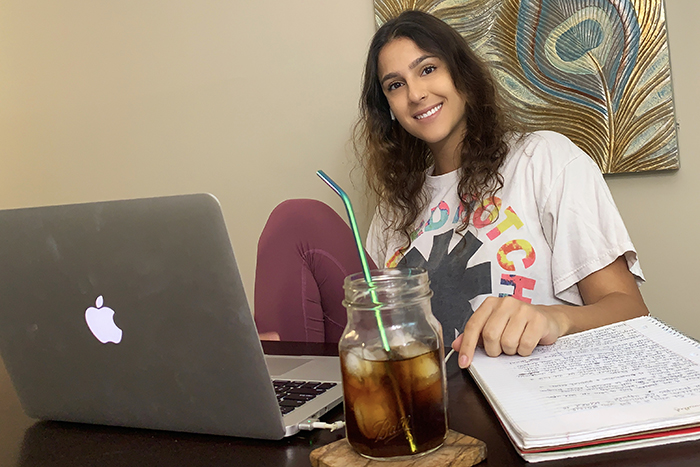 Sofia Garcia-Arias sits in front of a laptop