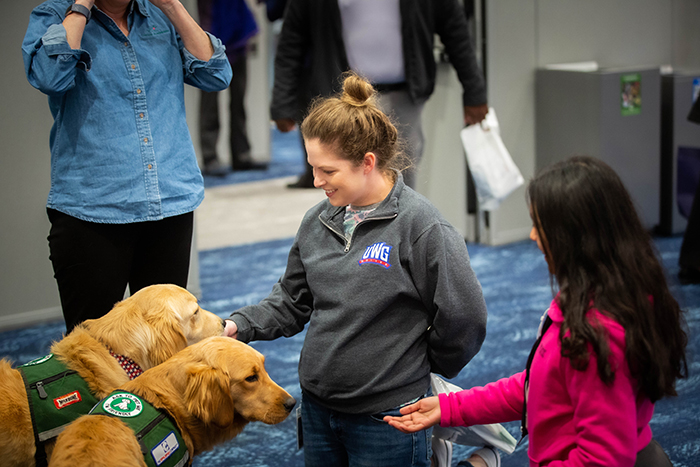 Emory employees pet a therapy dog