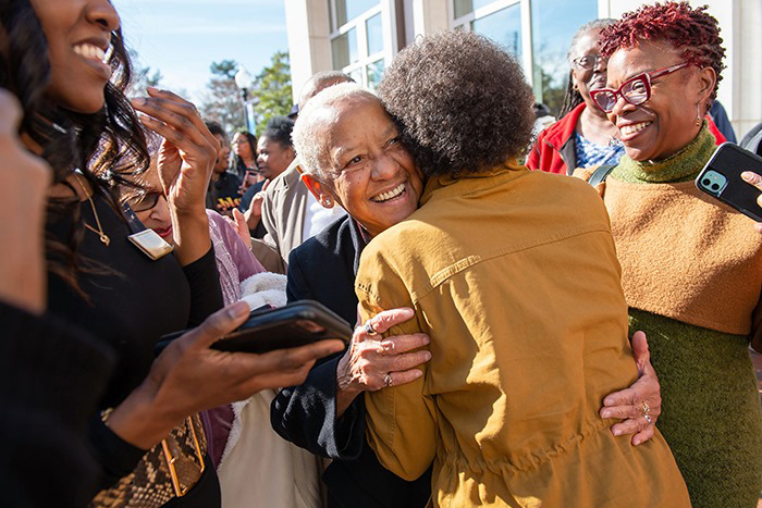 Nikki Giovanni hugs a fan
