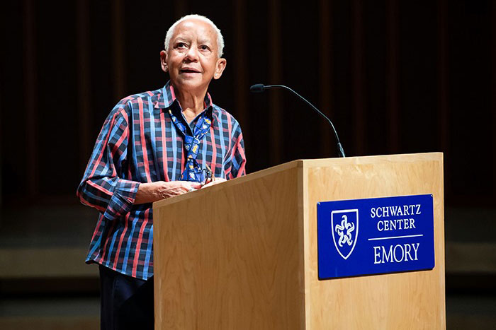 Nikki Giovanni speaks to the crowd from behind a podium